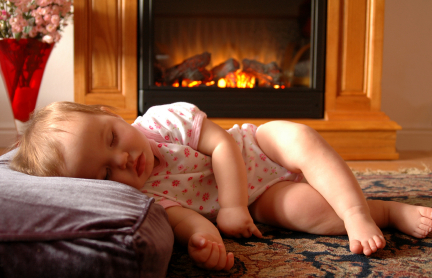 Baby Sleeping By Fire in a Comfortable Home With Central Heating